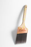 Paint brush. A professional painters paint brush on a neutral background Stock Image