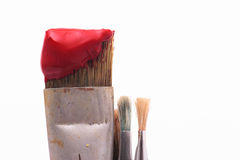 Paint brush. Red paint on a brush royalty free stock photos