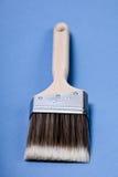 Paint brush. Single paint brush on blue background Stock Image