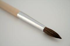 Paint brush. Close - up of paint brush isolated on white Stock Photography