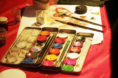 Paint and brush. Face paint and brush royalty free stock images