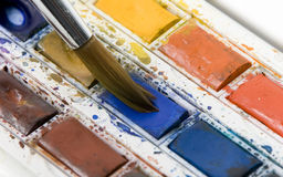 Paint Brush. Artist brush in water colours Stock Photos