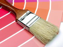 Paint brush and color swatches royalty free stock image