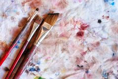 Paint brush and background. Paint brush and colorful rag background Stock Photo