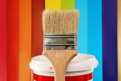 Paint brush on the background of the color palette. Stock Photography