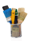 Paint brush and basket holder on white Royalty Free Stock Photo