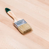 Paint brush on beech wooden board Royalty Free Stock Photo