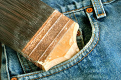 Paint brush and bluejeans. A paint brush in a bluejeans pocket Royalty Free Stock Image