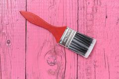 Paint brush on a board pink Stock Photography