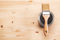 Paint brush on the can. Copyspace with paint brush on can lying on wooden clean table. Top view Stock Image