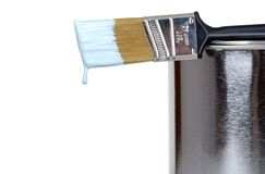 Paint brush on a can dripping Stock Photo