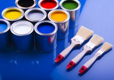 Paint brush and cans Stock Photos