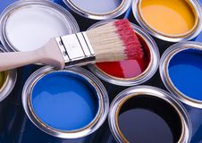 Paint brush and cans. Cans with paint and brushes on the blue background royalty free stock photo