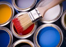 Paint brush and cans. Cans with paint and brushes on the blue background royalty free stock image
