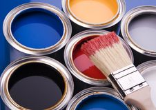 Paint brush and cans. Cans with paint and brushes on the blue background stock photo