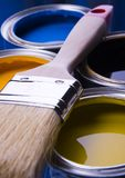 Paint brush and cans. Cans with paint and brushes on the blue background royalty free stock photography