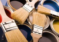 Paint brush and cans Stock Images