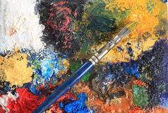 Paint brush and canvas Stock Image