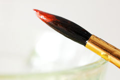 Paint and brush close up Stock Photos