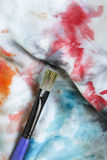 Paint brush on cloth Stock Photos