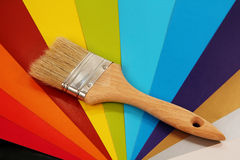 Paint brush on color background. Stock Image