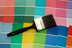 Paint Brush and Color Cards. A paint brush on paint color cards royalty free stock photo