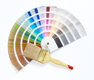 Paint brush and color chart. On white background stock photos