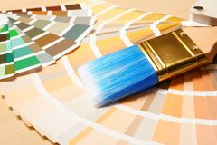 Paint brush and color palettes on table. Closeup royalty free stock images