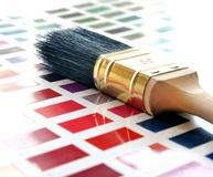 Paint brush and color swatch Stock Photography