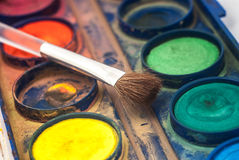 Paint and brush Stock Photography