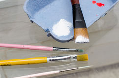 Paint brush and colors on glass table Stock Image