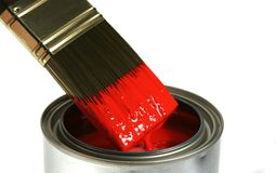 Paint Brush Dipped Into Red Paint stock image
