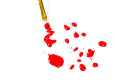 Paint brush with dops of red paint Royalty Free Stock Photography