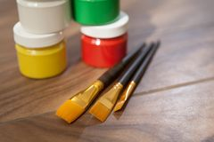 Paint and brush for drawing close-up. royalty free stock photos
