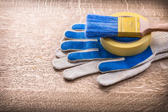 Paint brush on duct tape and gloves Stock Photos