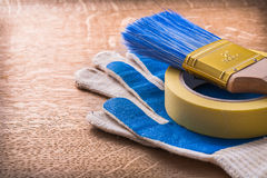 Paint brush duct tape and protective gloves on Stock Photography