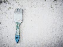 Paint brush on dusty grey background Stock Image