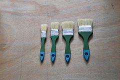 Paint brush. Four paint brush on wood Royalty Free Stock Images