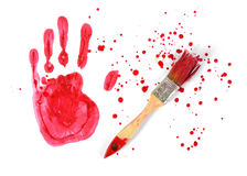 Paint brush and gouache red handprint on white canvas background in top view Stock Photography