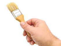 Paint brush in hand Stock Photos