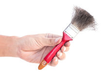Paint brush isolated on white background. Hand holding paint brush isolated on white background Stock Photo