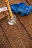 Paint brush in a jar filled with water and cloth Royalty Free Stock Photography