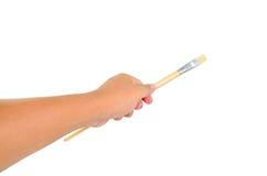 Paint brush in man hand Stock Photo