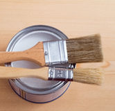 Paint brush on metall can over wood background Royalty Free Stock Photography