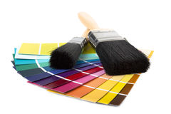 Paint brush and multi coloured swatches royalty free stock photography