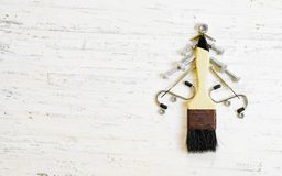 Paint brush and nuts and bolts decorated as christmas tree on a Stock Photos