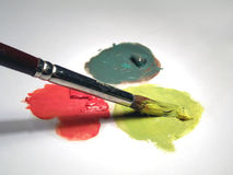 Paint brush and oil colors. Close up, over white Royalty Free Stock Photo