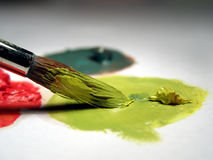 Paint brush and oil colors. Close up, over white Stock Photography