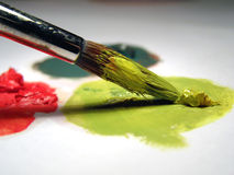 Paint brush and oil colors. Close up, over white Royalty Free Stock Image