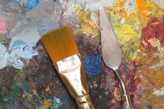Paint brush and old pallet Stock Images